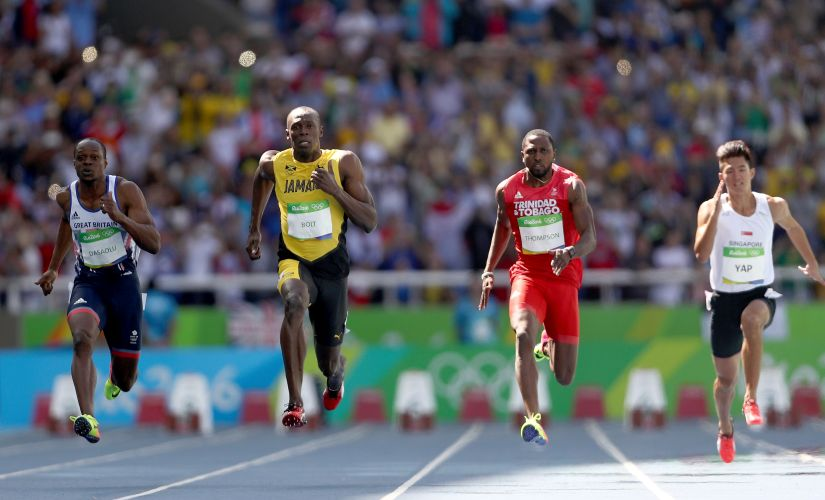 RIO DE JANEIRO, BRAZIL - AUGUST 13: James Dasaolu, Usain Bolt and Richard Thompson compete in round one of the Men's 100 Meters. Getty