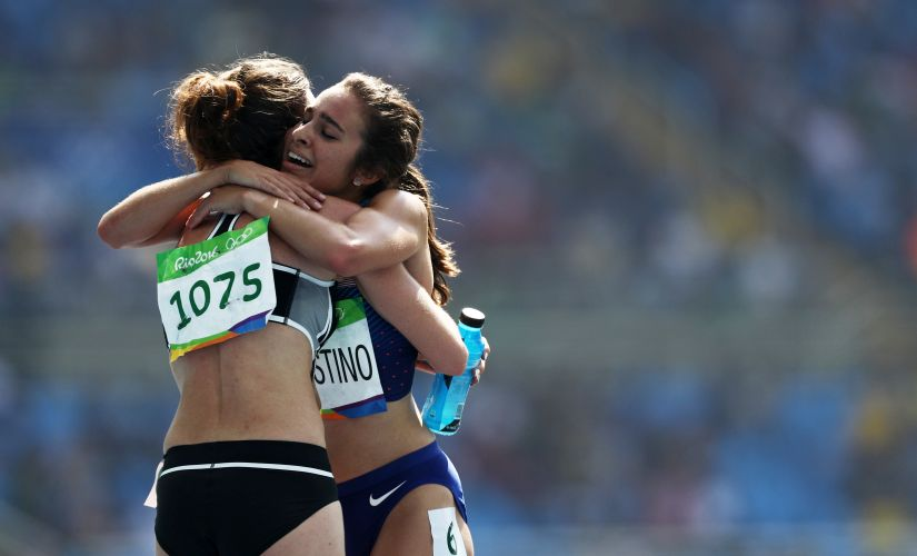 Abbey D'Agostino hugs Nikki Hamblin after the Women's 5000m Round 1. Getty