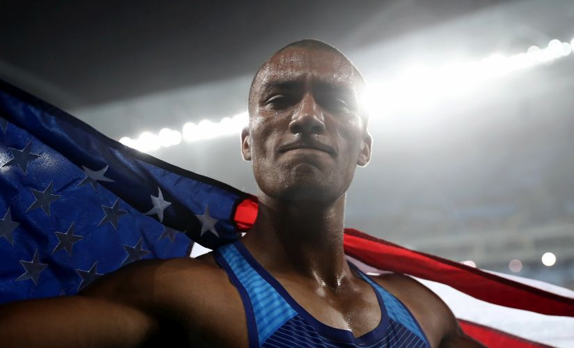 Ashton Eaton celebrates winning gold overall after the Men's Decathlon 1500m. Getty