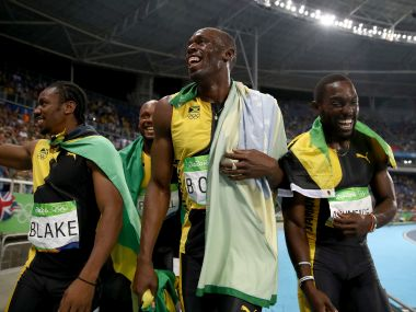 Usain Bolt celebrates with teammates Asafa Powell, Yohan Blake and Nickel Ashmeade after winning the Men's 4 x 100m Relay Final. Getty