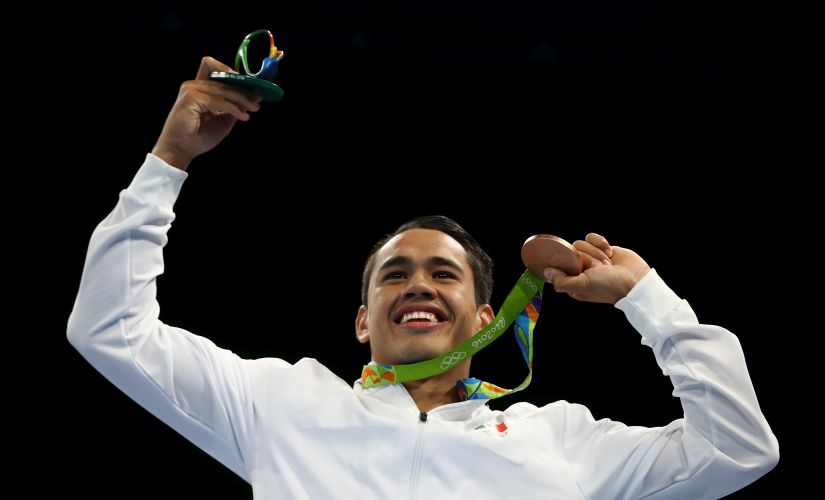 Bronze medalist Misael Uziel Rodriguez of Mexico poses during the medal ceremony. Getty