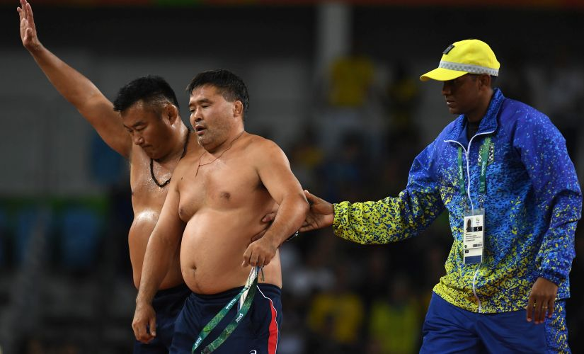 Rio Olympics 2016 Watch Mongolian coaches strip to underpants to protest wrestling result