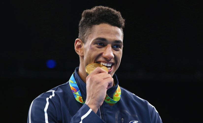 Gold medalist Tony Victor James Yoka of France poses on the podium during the medal ceremony. Getty