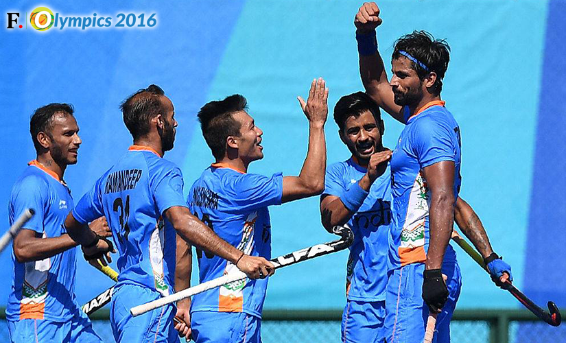 Rupinder Pal Singh celebrates with the hockey team. Getty Images