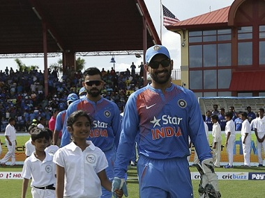 Indian skipper MS Dhoni leads his team onto the field before the first T20 match against the West Indies. AP