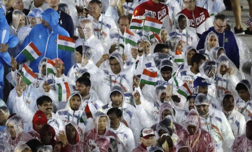 Athletes from India march into the closing ceremony. AP