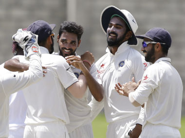 Indian players celebrate the fall of a West Indian wicket on the final day of the 3rd Test. AP