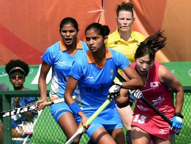 Indian and Japanese women hockey players vie for the ball during qualifying round at the Rio Olympics. PTI