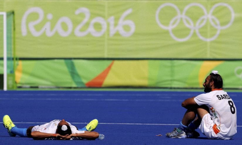 India's hockey players after they lost to Belgium in the quarter final of the Olympics. PTI