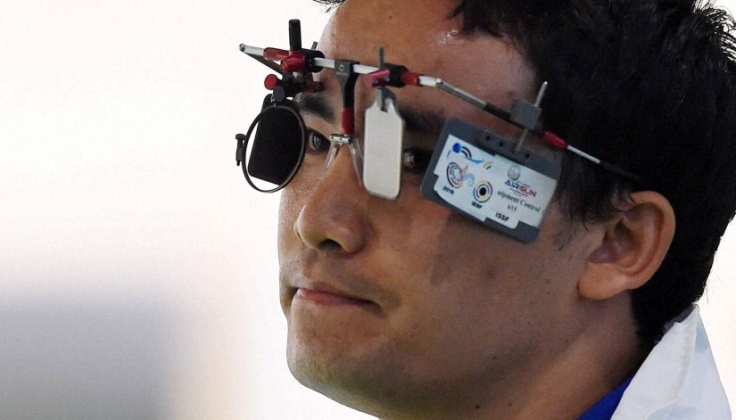 Jitu Rai reacts during the Men's 50m Pistol qualifying round. PTI