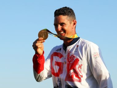 Justin Rose of Great Britain celebrates with the gold medal. Getty Images