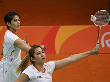 Jwala Gutta and Ashwini Ponnappa play against Eefje Muskens and Selena Piek of Netherlands in women's doubles badminton. Reuters