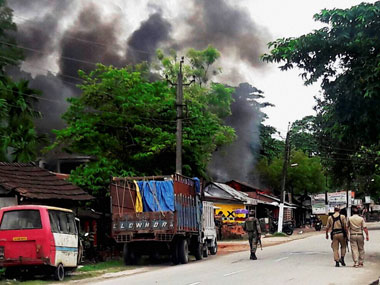 Kokrajhar: Smoke coming out of shops after an attack by NDFB (S) terrorists in the market area at Balajan Tinali near Kokrajhar town in Assam on Friday. PTI