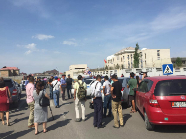 This photo was released by China's Xinhua News Agency, people gather near the site of the explosion in Bishkek, Kyrgyzstan on Tuesday. AP