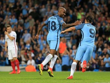 Manchester City's Fabian Delph and Nolito celebrate scoring a goal against Steaua Bucharest. AP