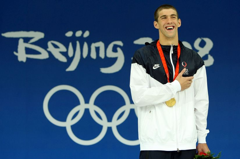 Michael Phelps receives the gold medal  in Beijing. Getty Images