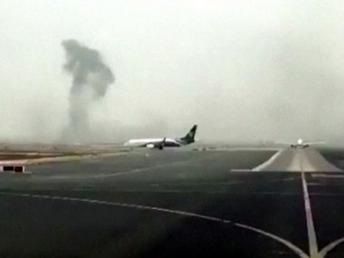 "This image made from video shows smoke rising after an Emirates flight crash landed at Dubai International Airport on Wednesday, Aug. 3, 2016. The plane at right was unaffected Dubai-based airline Emirates has confirmed that there were no fatalities on a flight from India that crash-landed . The carrier says ""all passengers and crew are accounted for and safe."" It raised the number of people onboard the flight to 300, saying there were 282 passengers, 18 crew.(Hayen Ayari via AP)"