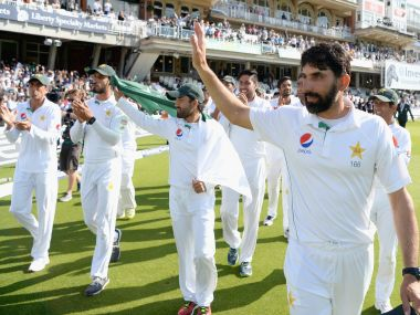 Misbah-ul-Haq leads his team on a lap of honour. Getty Images