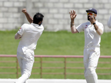 Mohammed Shami (left) celebrates the fall of a West Indian wicket with India skipper Virat Kohli. AP