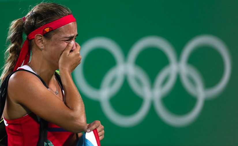 Monica Puig of Puerto Rico cries after winning the gold medal. AP
