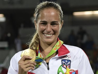 Gold medallist Puerto Rico's Monica Puig poses during the podium ceremony. AFP