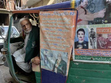 Pakistan's Olympian Muhammad Ashiq pictured in his auto-rickshaw in Lahore. AFP
