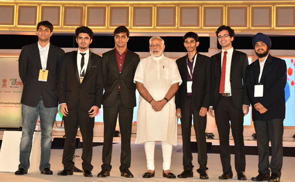 The Prime Minister, Shri Narendra Modi with the young contributors who developed the new PMO App, at the 2nd Year Anniversary celebrations of MyGov, in New Delhi on August 06, 2016. PIB