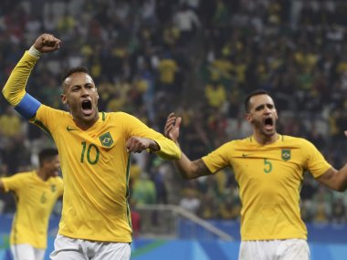 Neymar and Renato Augusto of Brazil celebrate victory against Honduras. Reuters