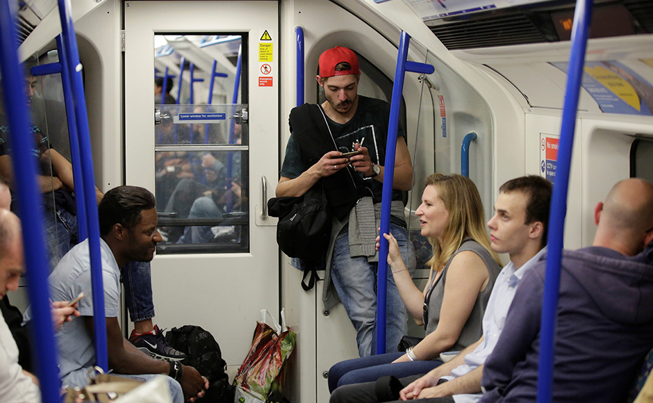Passengers travel on the Night Tube train service on the London underground system in London, Britain August 20, 2016. REUTERS