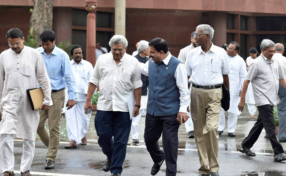 CPM General Secretary Sitaram Yechruy, CPM National Secretary D Raja, Defence Minister Manohar Parrikar leave after the all-party meet on Kashmir. Prime Minister Narendra Modi on Friday said the NDA-government is committed to restoring normalcy in the Kashmir Valley. PTI