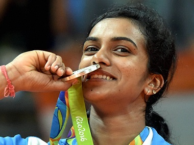 Rio de Janeiro: India's Pusarla V Sindhu poses with her silver medal after her match with Spain's Carolina Marin in women's Singles final at the 2016 Summer Olympics at Rio de Janeiro in Brazil on Friday. PTI Photo by Atul Yadav (PTI8_19_2016_000291B)