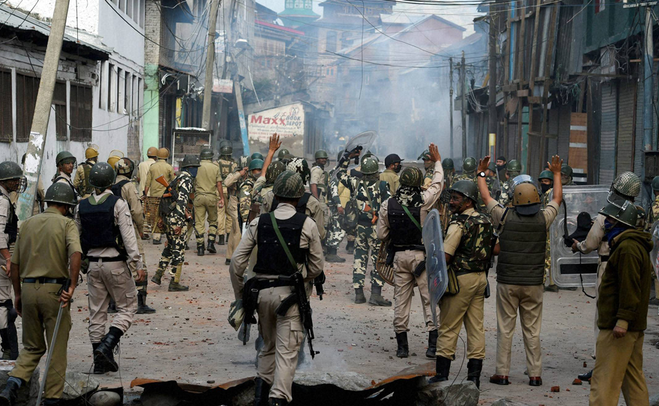 Security forces chasing away protesters during a clash in Srinagar on Monday. On 29 July, authorities had lifted curfew from entire Kashmir Valley except three police station areas after 51 days of continous curfew. PTI