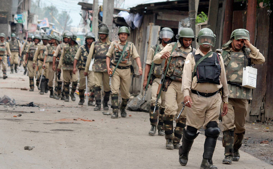 Security personnel patrolling a deserted street after curfew was again imposed following fresh clashes, at Batamallo in Srinagar on Monday. Clashes were reported from a number of places in Srinagar city but nobody was hurt in these incidents. PTI