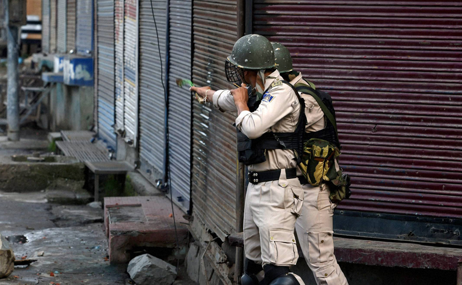 A jawan uses a sling shot to chase away protesters during the clash in Srinagar. Groups of miscreants pelted stones on security forces at Chattabal, Kani Kadal, Khanyar and Batamaloo areas of Srinagar. PTI