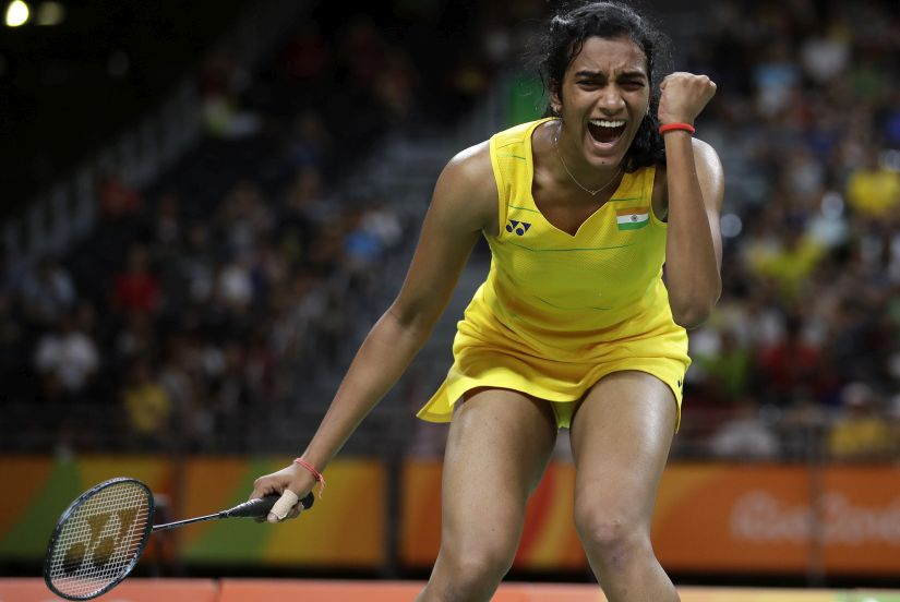Sindhu Pusarla reacts as she plays Nozomi Okuhara during her women's singles semifinal badminton match at the Olympics. AP