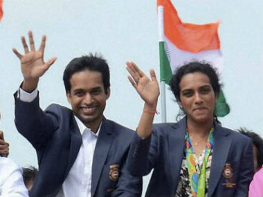 Olympic silver-medallist PV Sindhu and coach Pullela Gopichand during the open-top bus parade in Hyderabad. PTI