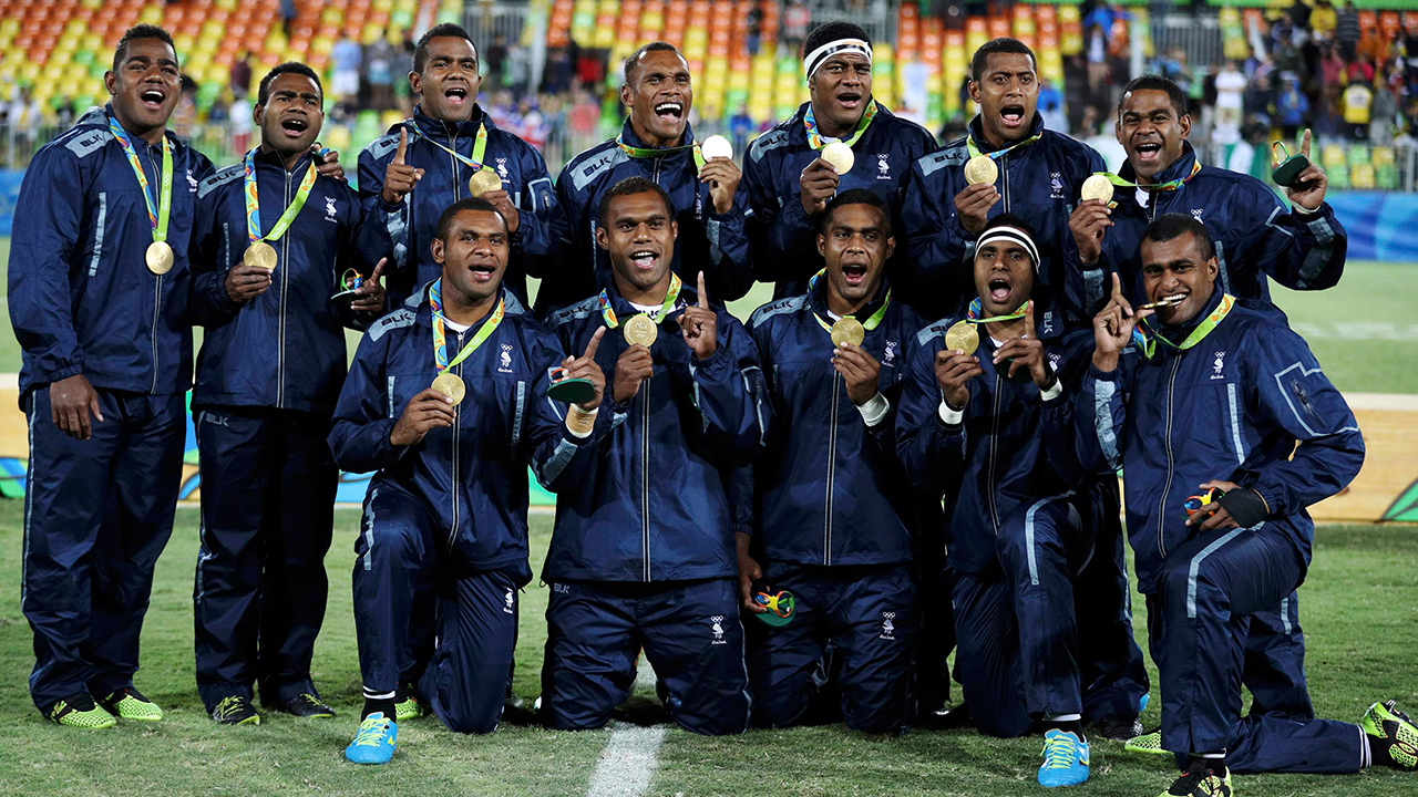 2016 Rio Olympics - Rugby - Men's Victory Ceremony - Deodoro Stadium - Rio de Janeiro, Brazil - 11/08/2016. Team Fiji pose for photos with their gold medals. REUTERS
