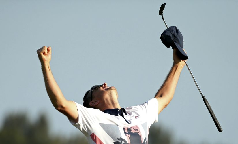 Justin Rose celebrates his gold medal win. Reuters