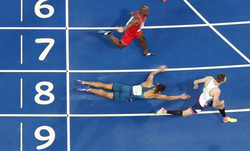 Joao Vitor De Oliveira falls between Andrew Pozzi and Mikel Thomas. Reuters
