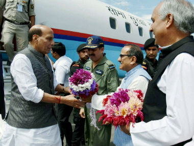 Union minister Rajnath Singh is greeted by Deputy Chief Minister of Jammu and Kashmir Nirmal Singh upon his arrival. PTI