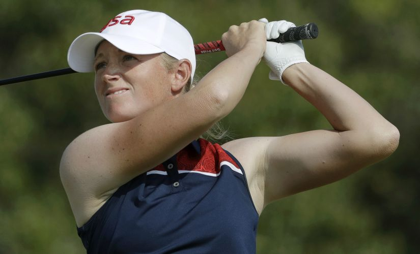 Stacy Lewis watches her tee shot on the 4th hole during the second round of the women's golf event. AP