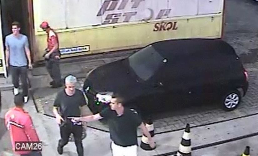 In this 14 August frame from surveillance video released by Brazil Police, swimmer Ryan Lochte and teammates, appear at a gas station. AP