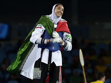 Kimia Alizadeh Zenoorin, of Iran celebrates after winning a bronze medal in women's 57-kg taekwondo competition. AP