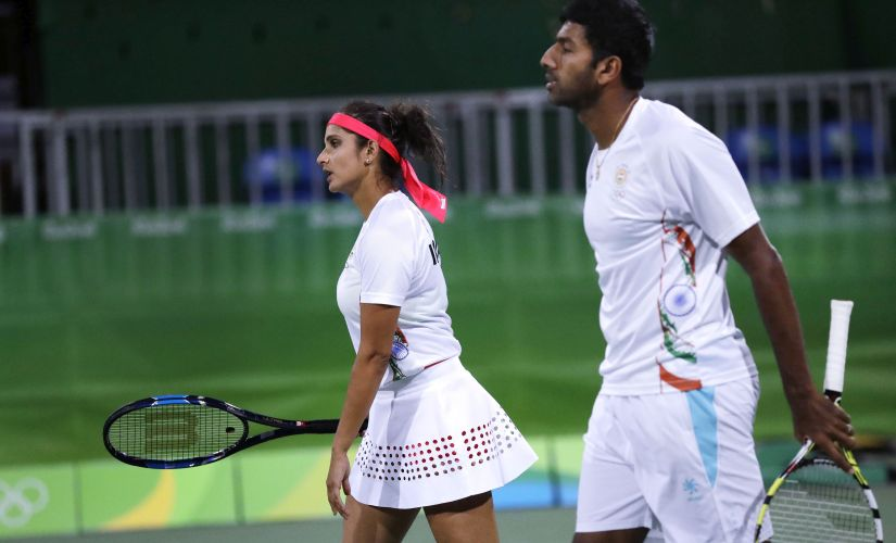 Sania Mirza and Rohan Bopanna head to their positions while trailing the United States. AP