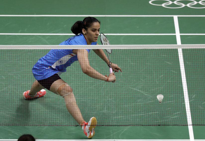 Saina Nehwal returns a shot against Brazil's Lohaynny Vicente during a women's badminton match at Rio Olympics. AP