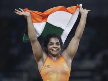 Sakshi Malik reacts after winning bronze in the women's wrestling event at the 2016 Rio Olympics. AP
