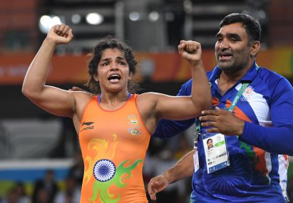 India's Sakshi Malik celebrates after winning against Kirghyzstan's Aisuluu Tynybekova in their women's 58kg freestyle bronze medal match. AFP