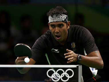 Sharath Kamal in action against Adrian Crisan of Romania. Getty