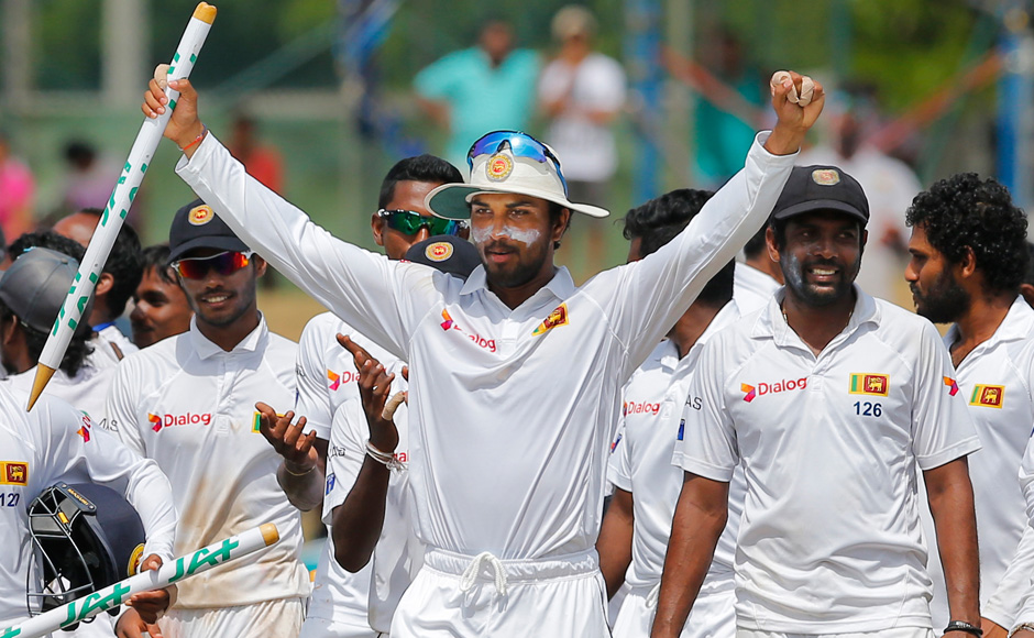 Set a formidable target of 324 in their second innings at Colombo's Sinhalese Sports Club (SSC), the world number one Test side collapsed in the afternoon session on the fifth day and were all out for 160. (Photo courtesy: AP)