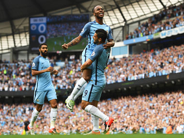 Raheem Sterling celebrates scoring the opening goal with Nolito against West Ham United. Getty